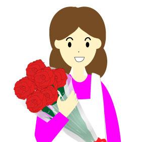 カーネーションの花束を受け取ったエプロンママ
