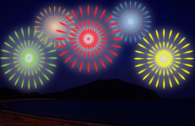 海の砂浜とカラフルな夏の花火