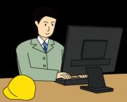 パソコンで仕事をする建設業関係者