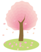 桜の木と春風に舞う花びら