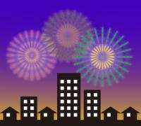 ビルなど建築物が立ち並ぶ住宅街の花火